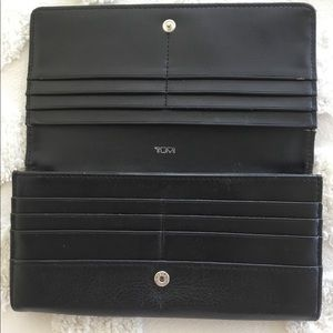 Tumi soft leather slim envelope wallet. Black
